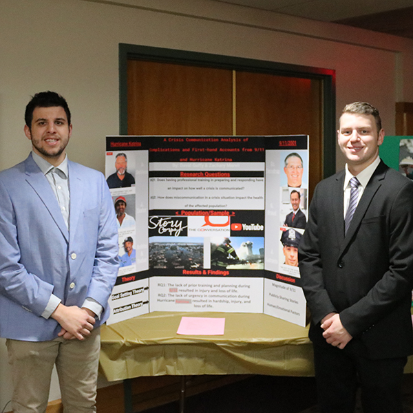 Students in front of a poster presentation