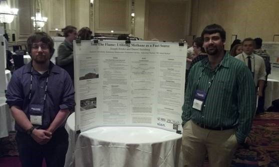 Students giving a poster presentation