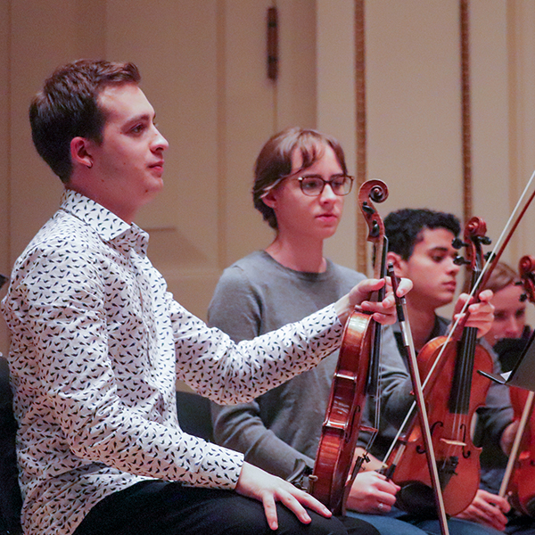 Students rehearsing at Weill Hall within Carnegie Hall.
