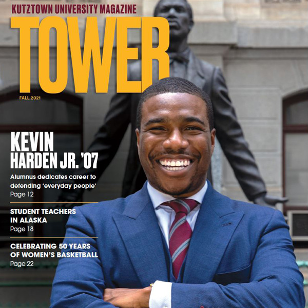 Cover of latest tower magazine, shows smiling graduate, with tower logo and story titles.